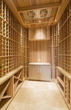 View of empty wooden racks in wine cellar