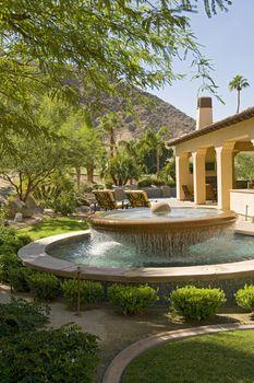 House exterior with fountain in garden