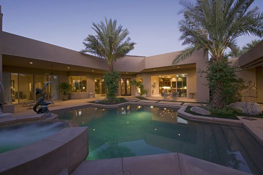 Swimming pool in back yard of modern residence