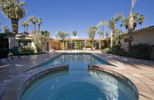 Swimming pool at back yard of luxurious residence