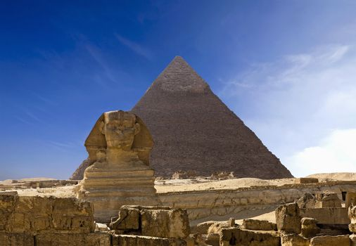 Cheops Pyramid And Sphinx In Giza