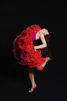 Woman dancing against black background