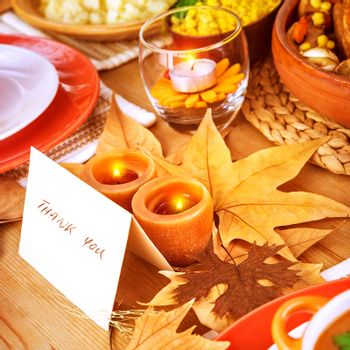 Thanksgiving day, post card on festive table with text, thank you, holiday dinner, candle light, beautiful decoration, happy celebration concept
