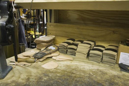 View of materials at traditional shoemaker workshop