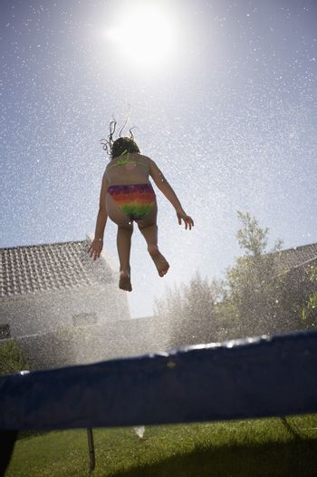 South Africa Cape Town girl jumping on trampoline
