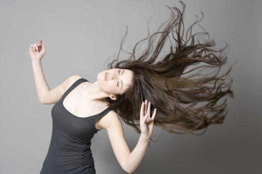 Woman with long brown hair dancing