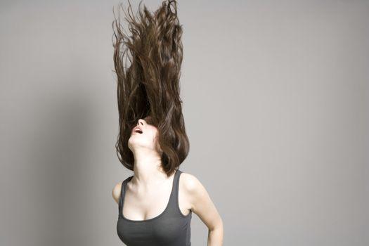 Woman tossing long brown hair