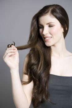 Woman twisting long brown hair