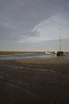 UK Norfolk sailboat in bay