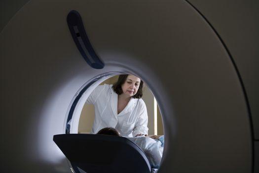 Medical exam in CAT scan machine