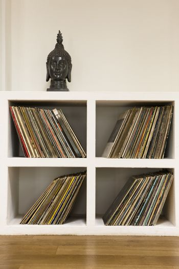 Closeup of vinyl records in shelf at home