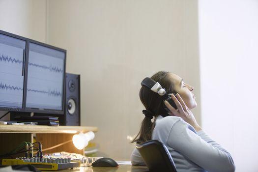 Sound engineer listening to music