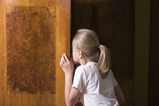 Girl opening wardrobe door