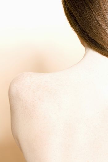 Close-up of young womans shoulder