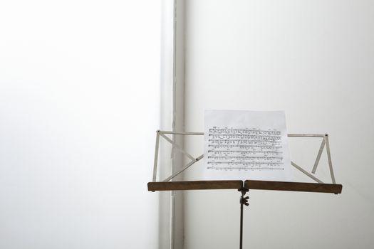 Closeup of a sheet music on music stand