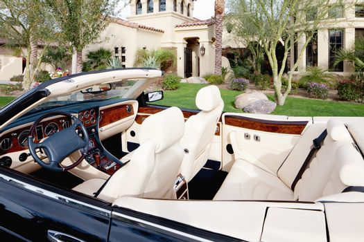 Close-up view of luxury car interior with white leather seats