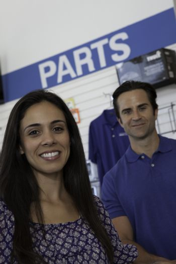 Portrait of cheerful woman at the automobile repair shop