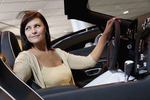 Attractive woman having a test drive