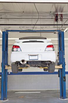 Cars on hoist at repair shop