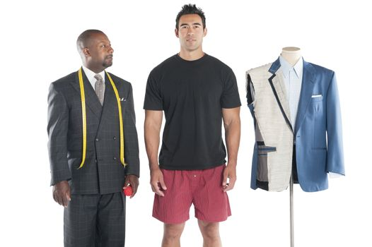 Tailor standing with his customer