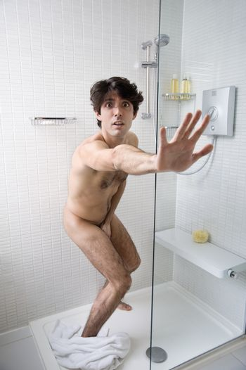Young man caught naked in bathroom