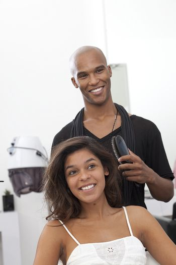 Woman getting her hair styled at beauty salon