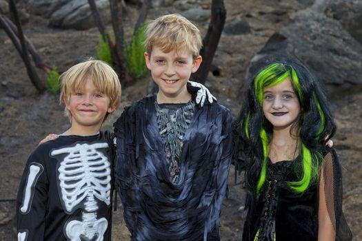 Portrait of three friends in Halloween costume