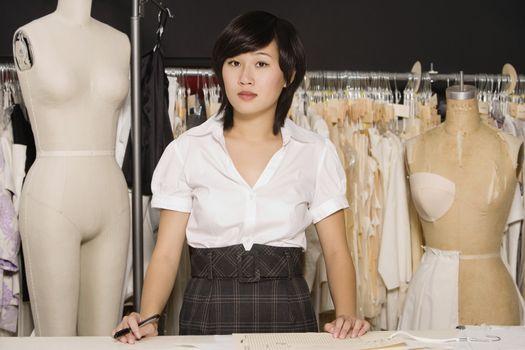 Portrait of female dressmaker at clothing store