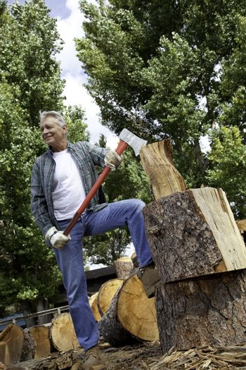 Low angle view of man holding an axe