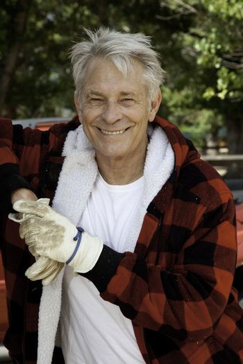 Portrait of wood cutter smiling