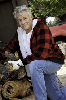 Portrait of senior man working at lumber industry