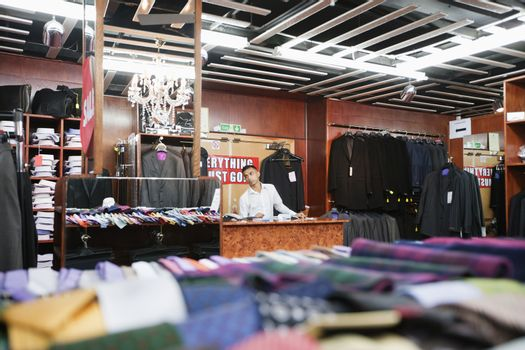 Man working in a clothing store