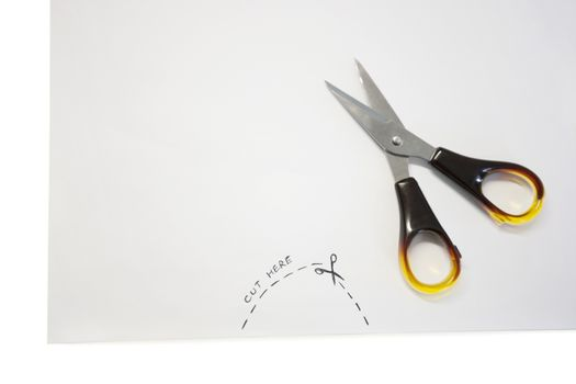 Scissor kept on paper with instructions written on paper