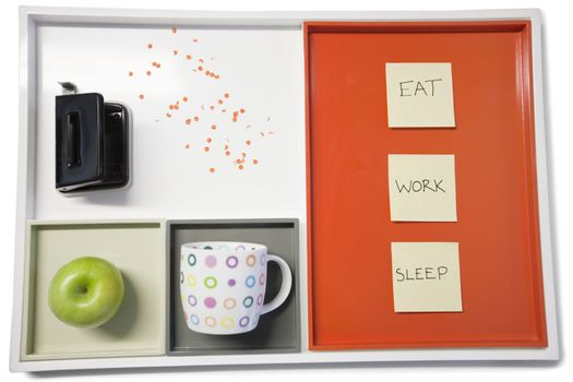 Tray with punch machine, green apple, cup and sticky notepapers