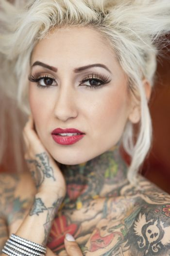 Portrait of blond woman with tattoos