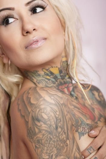 Close-up of a tattooed woman looking away