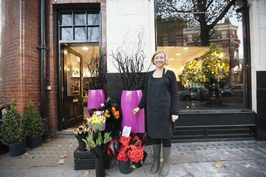 Portrait of florist standing in front of her shop