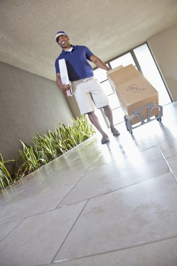 Tilt image of happy delivery person with packages