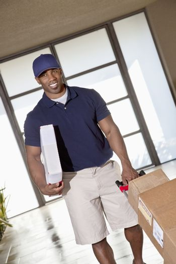 African American man with packages to deliver