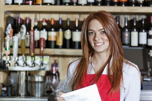 Portrait of a beautiful young waitress