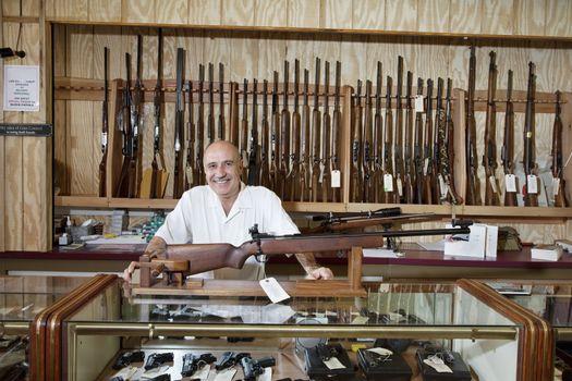 Portrait of a happy weapon shop owner
