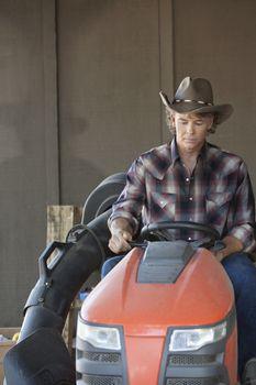 Cowboy driving utility vehicle