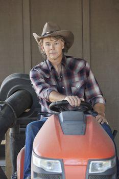 Portrait of a cowboy driving utility vehicle