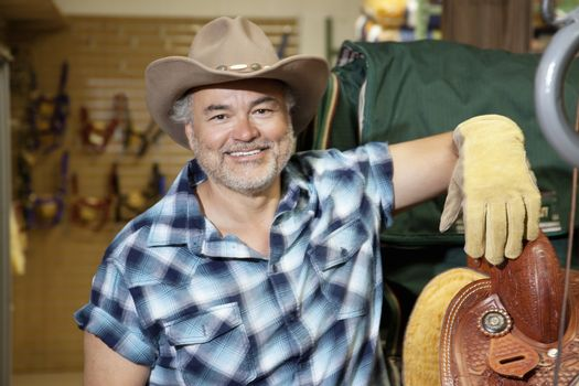 Portrait of a happy mature cowboy in feed store