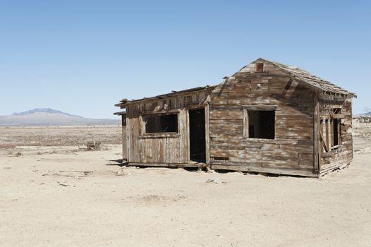 Timber home on arid landscape