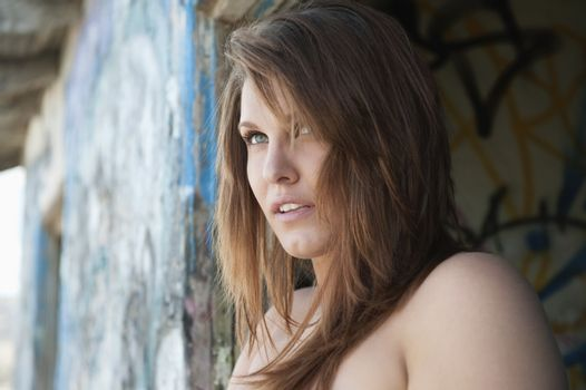 Attractive young woman looking away