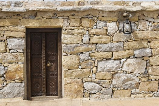 Dubai UAE Detail of stone huts on display at Heritage Village in Bur Dubai