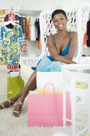 Woman sits in retail department