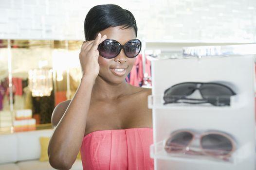 Woman tries sunglasses