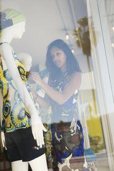 Shop assistant dresses mannequin
